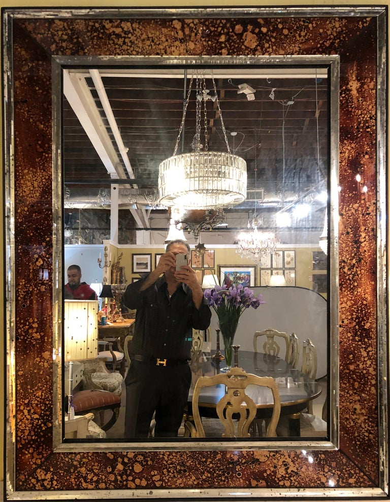 Hollywood Regency tortoise shell design wall, console over the mantle mirrors. A pair of simply stunning show stopping wall or console mirrors. Each tortoise shell fashioned border framed with a distressed beveled frame mirror. The whole framing a