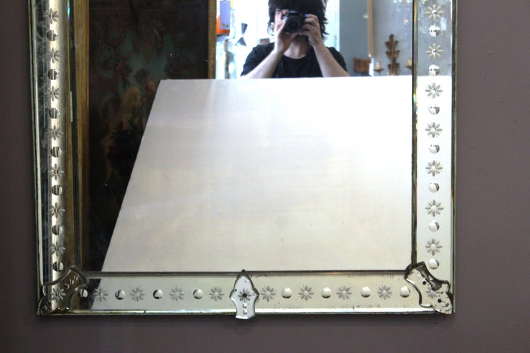 Italian Hollywood Regency Venetian pair of rectangular wall mirrors with decoratively etched borders. Likely manufactured in Italy during the 1920s, the pair is in great vintage condition with age-appropriate wear and use.