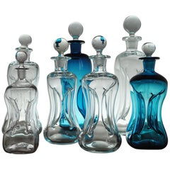 "Holmegaard ""Klukflasker"", Set of 7 Mouth Blown Cluck Bottles or Decanters"