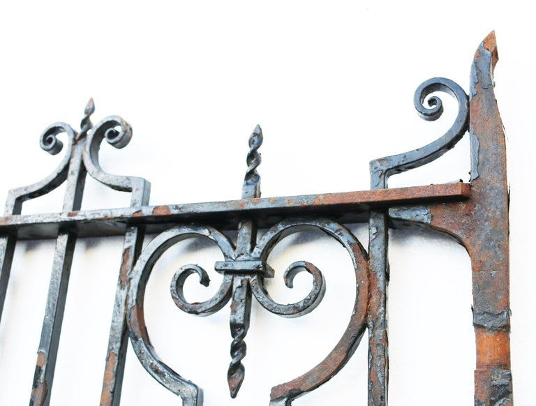 About:  A good quality English garden gate removed from a Norfolk Estate. Monogrammed 'SB'. This gate is hand forged wrought iron and has old black paint. We have two very similar gates available.   Condition report:  In excellent structural