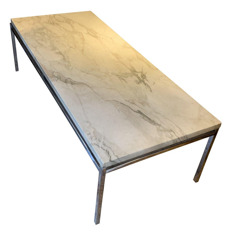 Midcentury French honed white marble-top coffee table. Beautiful grey veins run through the tabletop. Simple design nickel base.