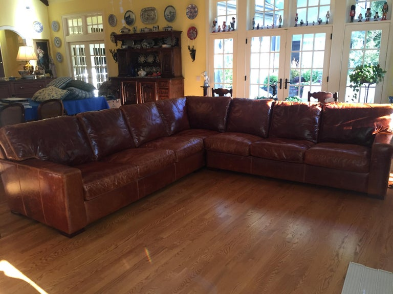 All leather sectional in three parts American made by American Leather Co. two sections are 84 inches long with a corner section of 41 by 41 inches. The total length is 125 inches on each side. The sections are held together with a locking mechanism