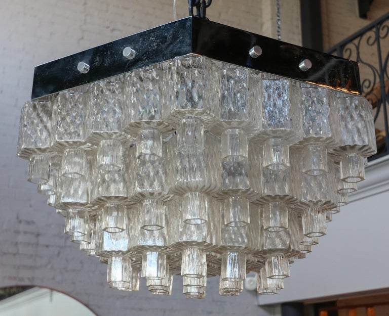 Italian 1960s chandelier in a honeycomb hexagon shape, with hexagon shaped textured clear glass on a chrome frame.