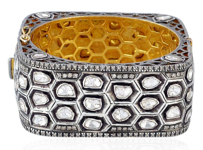 The Maharaja collection inspired by the Moghul Era & Indian heritage. A stunning bracelet handmade in 14K gold and sterling silver. It is set in 16.04 carats of uncut rose cut diamonds. Clasp Closure  Please note that carat weights may slightly vary