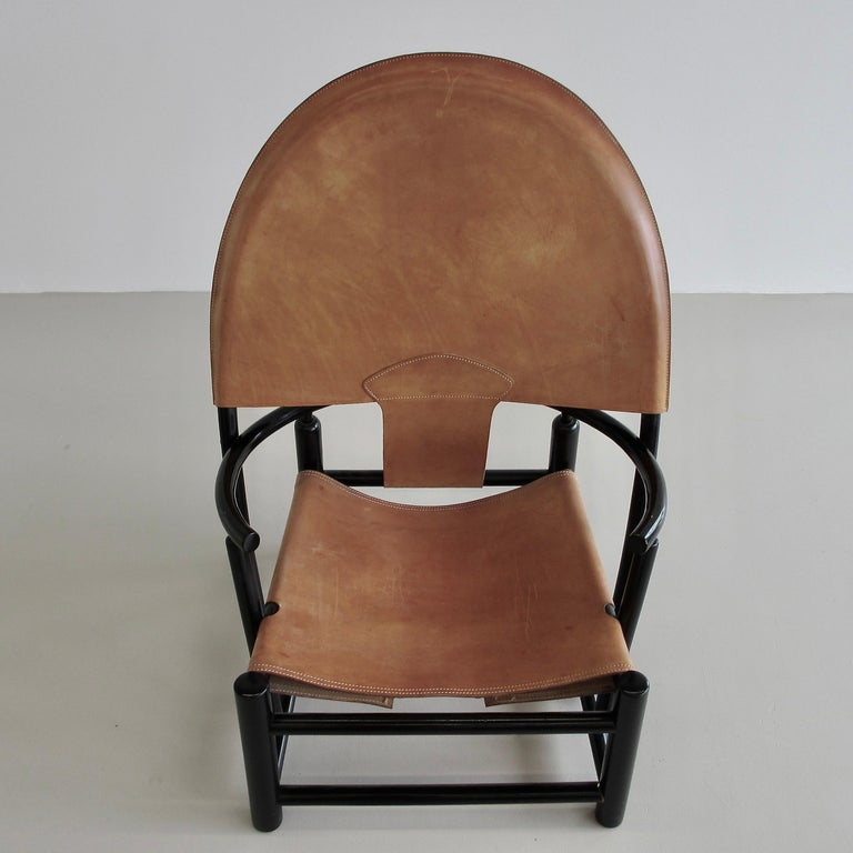 Armchair designed by Piero Palange and Werther Toffolon. Italy, Germa, 1972.  Black lacquered wooden frame with the original leather upholstery. This is model G23. Seat height: 35 cm.