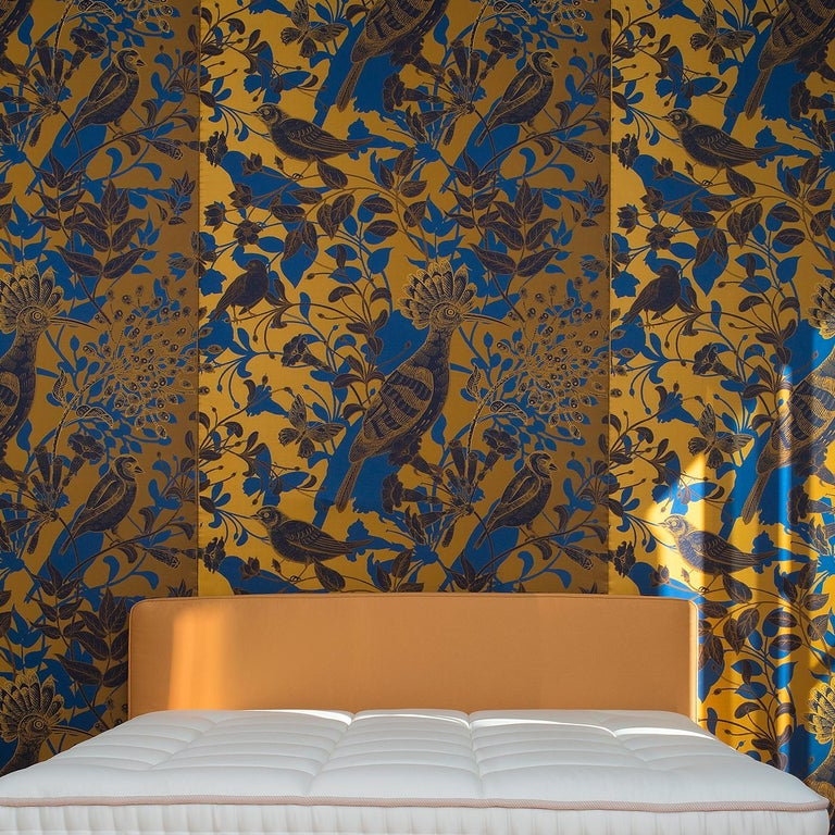Bold and elegant, this wall covering is part of the Jungle Dream, aptly named after is contrasting color palette, the use of both geometric and naturalistic patterns, and the mesmerizing design. It was crafted of silk and cotton and can be a