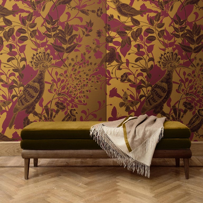 This unique wall covering is part of the Hoopoe Birds collection, crafted of silk and cotton and depicting a dream-like scene in which European birds, flowers, and butterflies cast their red shadow on a golden background. Mesmerizing and visually