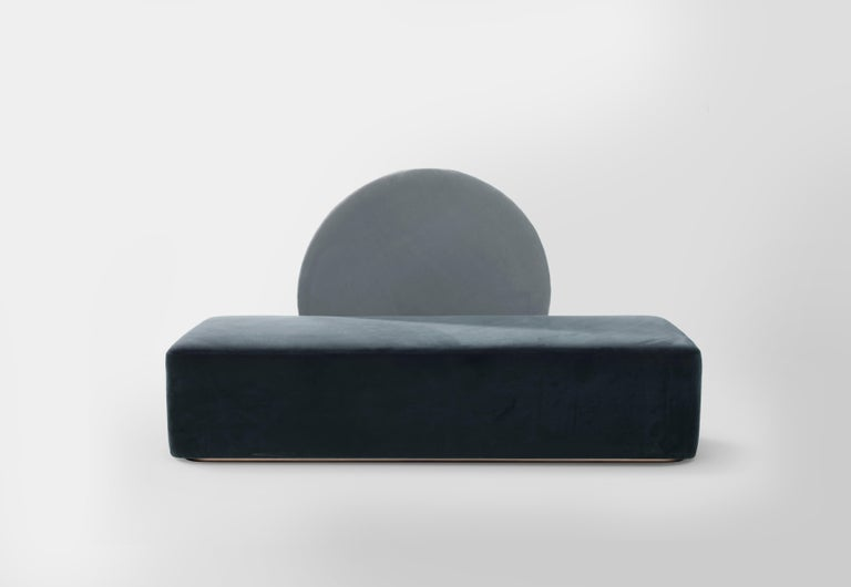 The Horizon sofa has been designed with a loose circular backrest. It rests on a metal frame allowing it to be rolled from one side to the other. This backrest insists that when two people want to use the daybed they must share with one