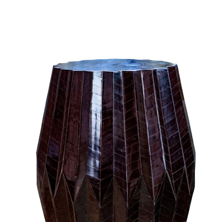 Resembling its namesake, the Tabla which is an Indian percussion drum, this end table flaunts a sculptural form. Thus Award winning table is made with a wood base and topped with angular bone chips to create a tonal pattern on a rhythmic form. The