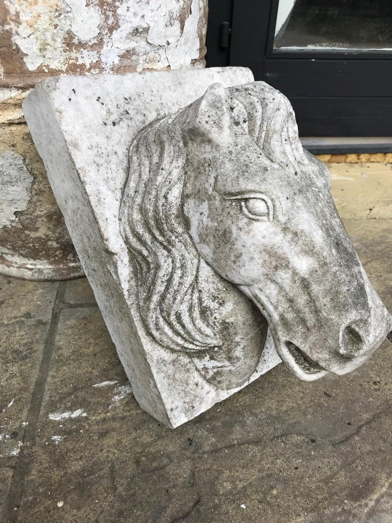 An elegant marble sculpture of a horse head used as a keystone most probably for an archway. French, early 20th century. Some damage to an ear and a visible signs of wear. One side of the horses head appears more weathered than the other half.