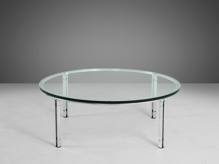 Horst Brüning for Kill International, coffee table, steel and glass, Germany, 1970s  Round cocktail table in chrome plates steel and glass. The design by Brüning is simplistic, yet due the combination of materials, this table gets it