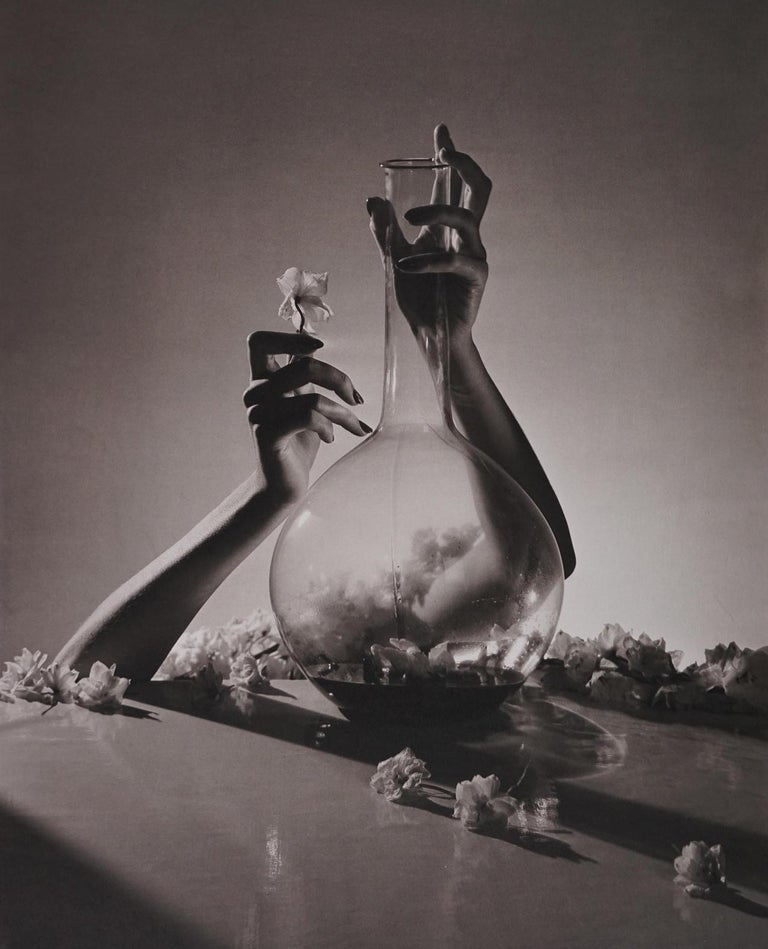 Horst P. Horst Black and White Photograph - Lisa, Hands with Flast & Flowers