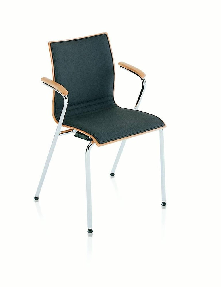 A structure in chrome-plated steel and body in beech plywood with or without arms in solid wood. All the chairs and armchairs are available in either wood or in an upholstered version. In hot the upholstery is available only in the front part of the