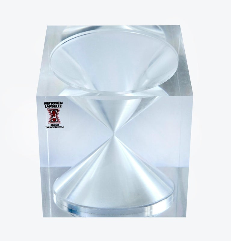 In the mid-1960s a small number of these exquisite hourglass cubes -- designed by Finnish design legend Tapio Wirkkala -- were made with great precision of clear acrylic and white sand to raise money for the Mannerheim League for Child Welfare. The