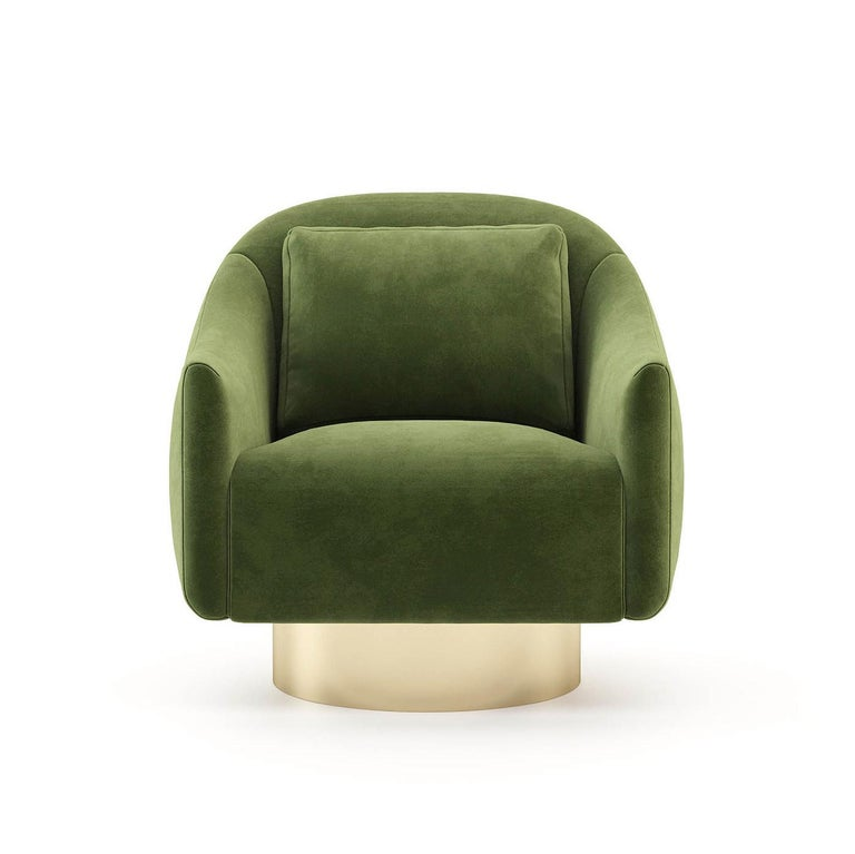 Armchair Howard with structure in solid wood, upholstered and covered with high quality green velvet fabric. With polished stainless steel base in gold finish. Also available with other fabrics on request.
