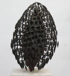 """""""Generation"""" its core surrounded by multitudes of tiny offspring in deep bronze"""