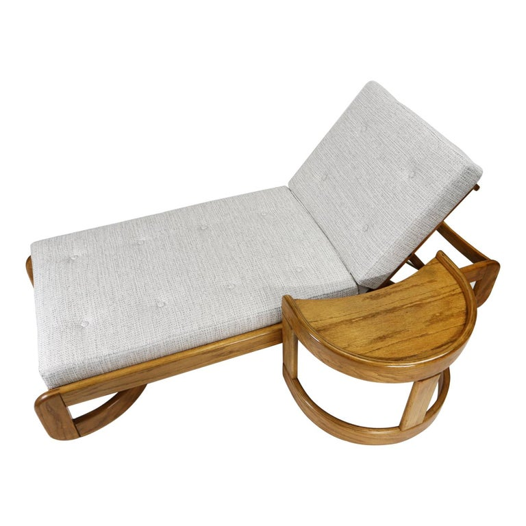 Incredibly versatile indoor chaise lounge by Howard Furniture. We've had a few pieces from Howard in the past, and they have always been hits! This particular line by Howard is crafted solid oak. This is the old growth, greatest generation, stuff