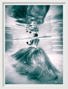 Underwater Study #3180 - model in dress swimming in water in sepia