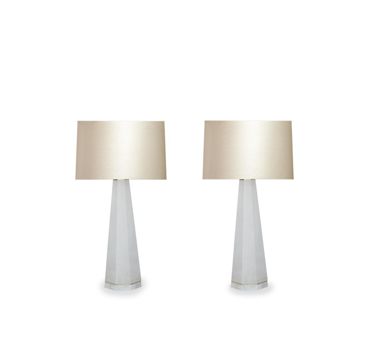 Pair of column rock crystal quartz lamps with polished brass decoration. Created by Phoenix Gallery, NYC. Measure: To the top of rock crystal 19.5