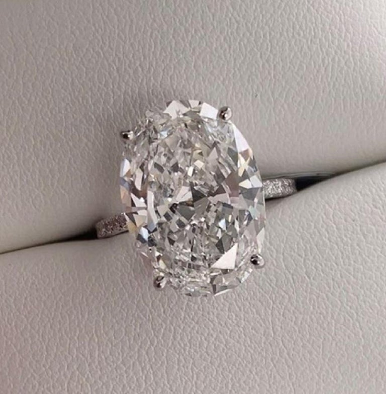 An exquisite oval diamond ring composed by a perfect 10 carat oval diamond  the stone has F color and VS2 clarity and triple excellent cut and polish  consider the pave of diamonds weights approx. 0.50 carats and is composed by vvs/vs clarity f