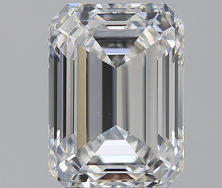 An important ring centering a 3 carat E Color rare white color VVS2 Clarity emerald-cut diamond. This amazing stone is one of the best cut diamonds we have, and gives the appearance of a much larger stone. Mounted in platinum with side diamond.