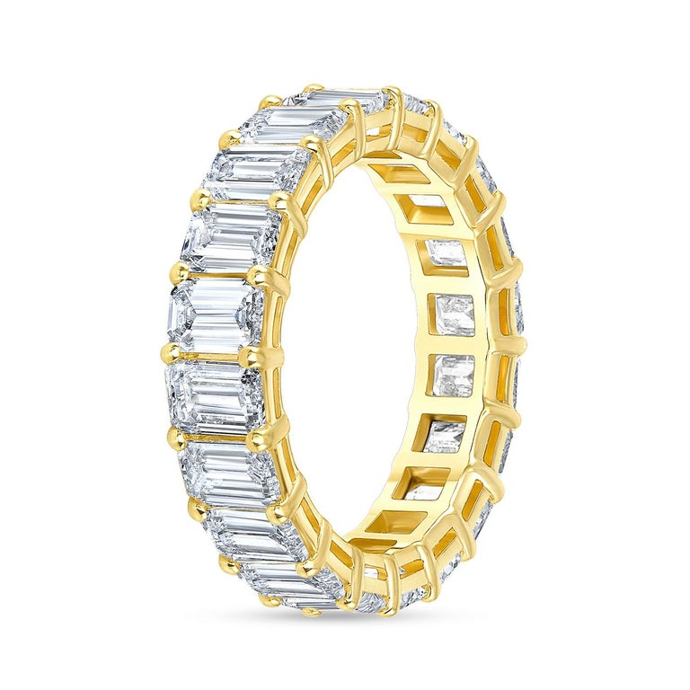 A fine and impressive 5.65 carat Eternity Diamond Ring. The Diamond Band Ring is set with 22 Emerald Cut Diamond weighing approximately 0.25 Carat each. The diamond color is F/G, and the quality is VS. The band rings is made to order, which means