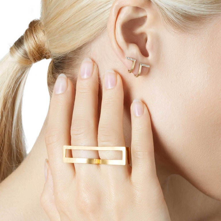 Unfinishing Line collection exudes minimalism and precision with its smooth lines and angles. Detailed with a curved structure and matt brushed finish. 18-Karat Yellow Gold Diamond Curve Earrings is perfect for day to night wear due to the