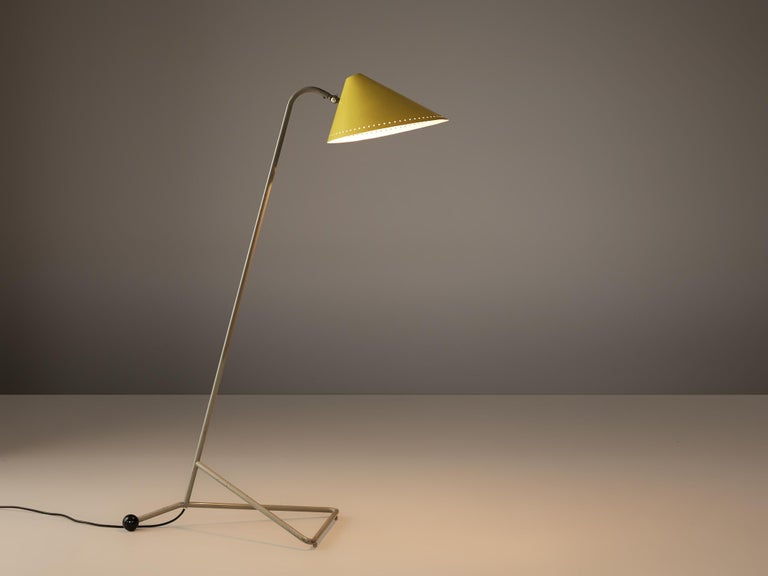 H.Th.A.Busquet for Hala Zeist, floor lamp, metal, the Netherlands, 1960s  With its yellow shade this Dutch lamp catches the eye. The conical shade is held by a slim metal base with a highlighted black ball end. The lamp has a playful character