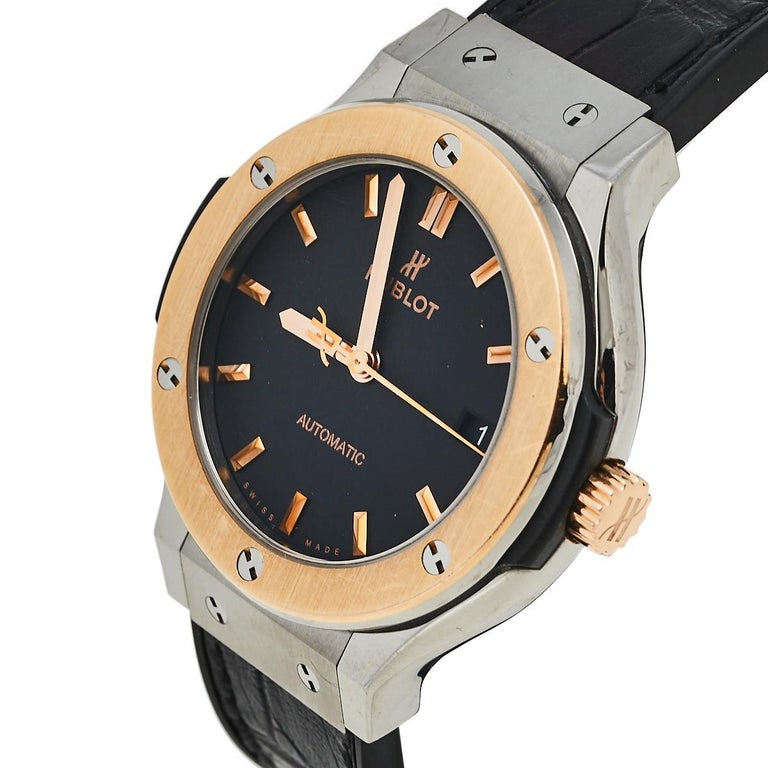 Not only is this stylish Hublot Classic Fusion wristwatch comfortable to wear, but it's also well-crafted and attractive. The titanium case with an 18k rose gold bezel surrounding a black dial on a tonal leather strap looks elegantly timeless. Its