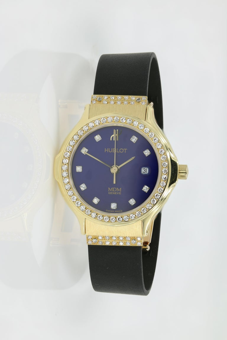 Hublot Watch - Ladies 18kt Yellow Gold with Diamonds (Pre-owned).  - Diamond bezel, markers & lugs (abt. 0.54ct) Blue Dial on new Rubber straps w/Deployment clasp - Fully restored at Hublot USA. Strap sizes are 139.10.61