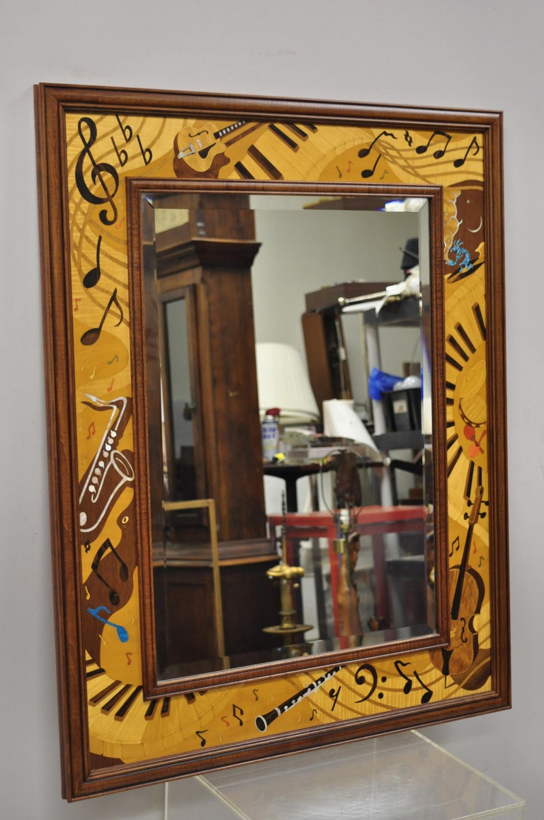 Hudson River inlay Marquetry inlaid Jammin' large border beveled glass mirror. Item features multiple wood inlays and mother of pearl, all done by hand. Beveled glass mirror, solid wood frame, beautiful wood grain, quality craftsmanship, great style