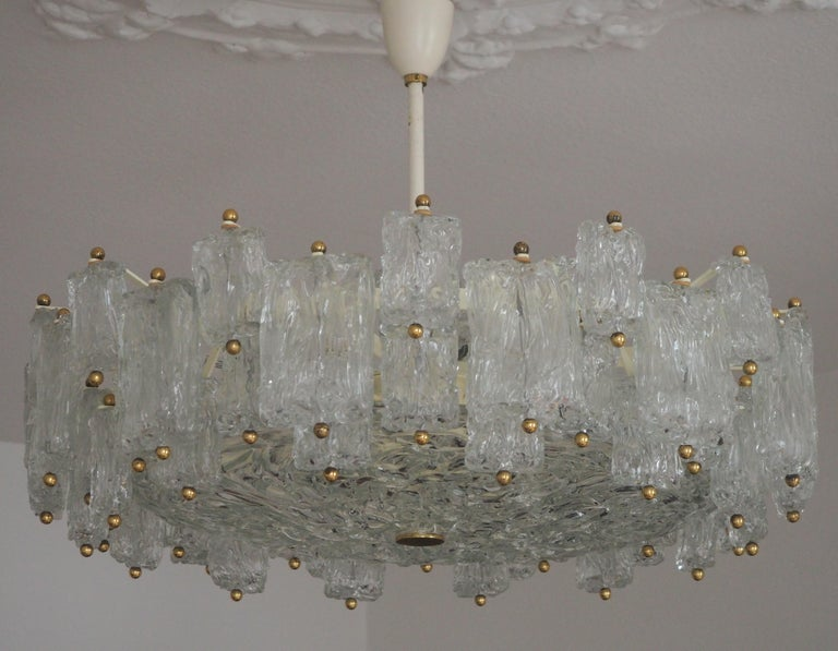 A stunning sixteen-light chandelier by Aureliano Toso, Italy, circa 1960. This beautiful chandelier is made of amazing textured glass, lacquered metal and brass.  In an excellent condition.