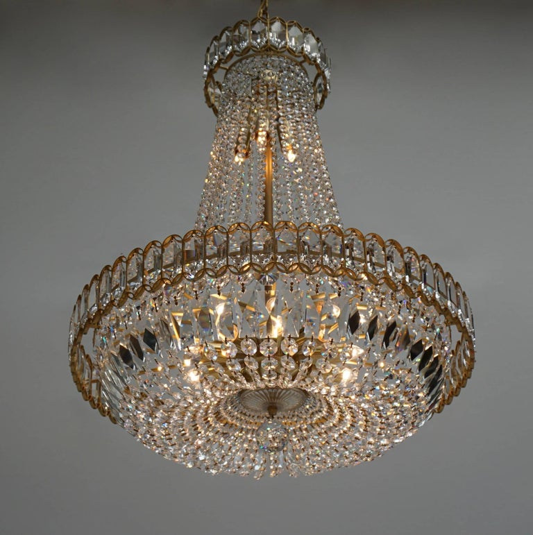 A large and impressive chandelier or pendant light by Bakalowits und Soehne, Austria, manufactured in midcentury, circa 1970. The fixture is handmade and high quality pieces. A brass frame is decorated with diamond and rose shaped crystal glass.