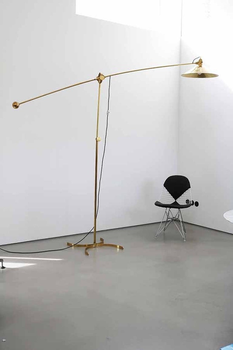 Very huge and rare floor lamp in good condition with only minor signs of use and natural patina. The swivel (including the lamp shade) measures 270cm/ 106 inch in length, the lamp shade 49cm/ 19inch in diameter. Due to the counterweight the height