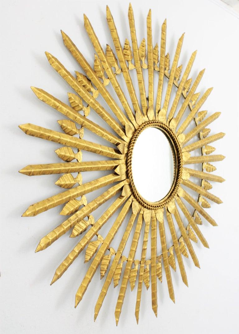 Spanish Huge Brutalist Hand-Hammered Gilt Iron Leafed Sunburst Mirror, Spain, 1950s For Sale