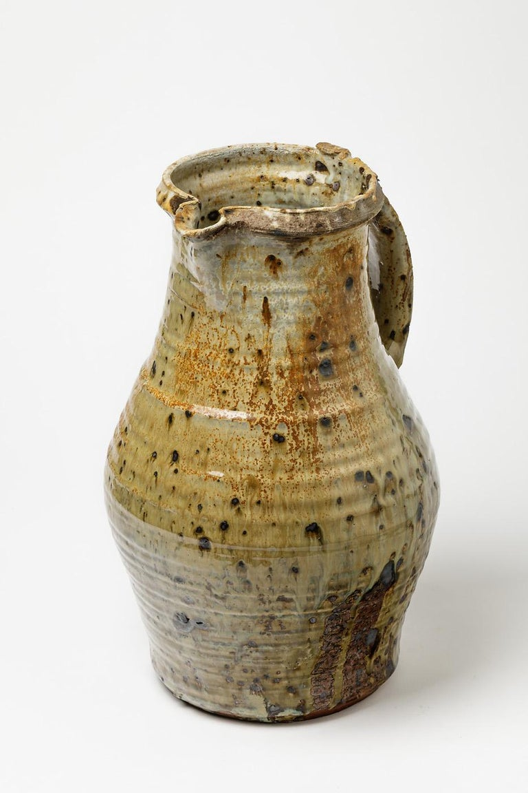 Anne Kjaersgaard (1933-2009)  Huge and amazing stoneware pottery pitcher by the Danish artist.  Amazing firing color really shinny.  Rare and collectible ceramic piece.  Dimensions: 35 x 25 x 22 cm.