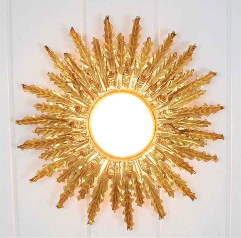 Mid-Century Modern Huge Gilt Iron Leafed Sunburst Flush Mount Light Fixture or Mirror, Spain 1940s For Sale