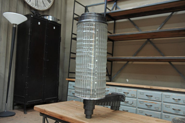 Very large and rare and great quality Holophane hotel wall lantern light in cast iron base with typical 1925 Art Deco decor, thick prismatic glass and metal cap to unscrew and change bulbes. Lampe rewired for screw bulbes all in excellent condition,