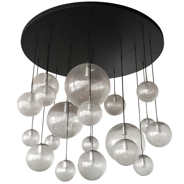 An extra large pendant light model no. 2525 by Kalmar, Austria, manufactured in 1978. This piece is a custom made light by Austrian lighting maker J.T. Kalmar. The original invoice from 1978 is still available. The light consists of a matt black