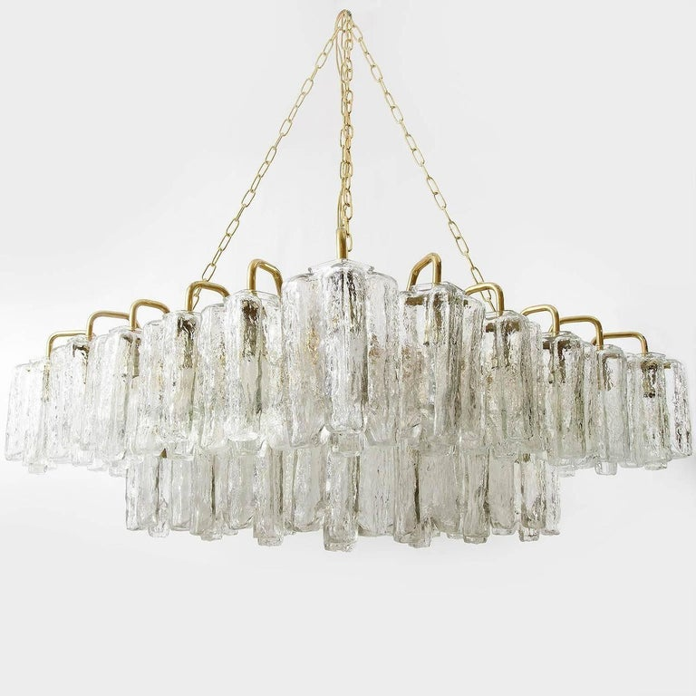 One of four square and extra large 'Granada' (engl. 'Grenada') light fixtures by J.T. Kalmar, Austria, manufactured in midcentury, circa 1970 (late 1960s or early 1970s). The lamps can be used as pendant light / chandelier or as flushmount light