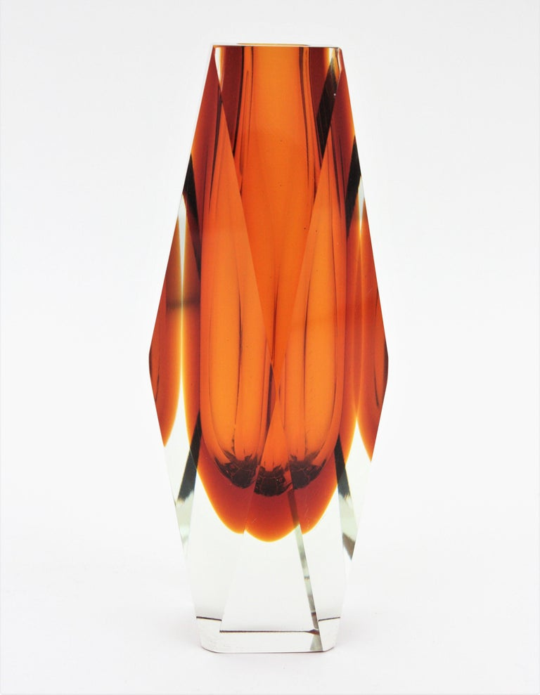A gorgeous extra large Sommerso faceted orange and clear Murano glass vase. Attributed to Mandruzzato. Italy, 1950-1960. Faceted Murano glass with sommerso technique in two tons of orange cased into clear glass. Gorgeous placed as a part of a set