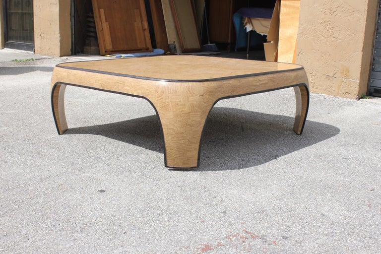Huge Mid-Century Modern Maitland Smith tessellated stone coffee table. Made in the 1970s. The coffee table is beautiful with two color of tessellated stone. Brown color and black color stone frame, the table are in very good condition. Dimensions: