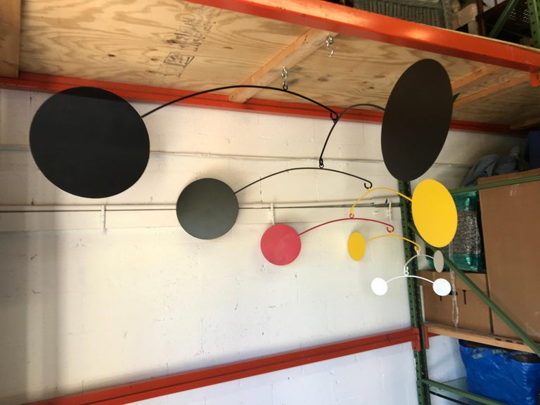 Stunning eight-arm Kinetic mobile, with eight interchangeable arms with vibrant orange, red, black, yellow and white spheres. The measurements of the mobile as shown is 64