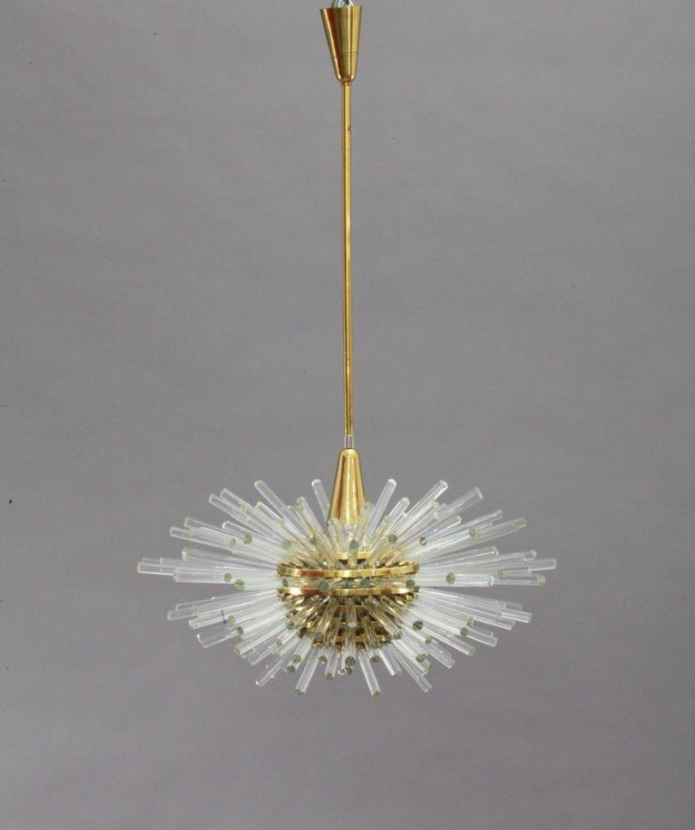 A fantastic huge Sputnik chandelier by Bakalowits & Sohne, Austria, manufactured in Mid-Century (late 1960s or early 1970s). A layered multi-tier structure made of brass rings and glass rods with faceted ends in different length. 