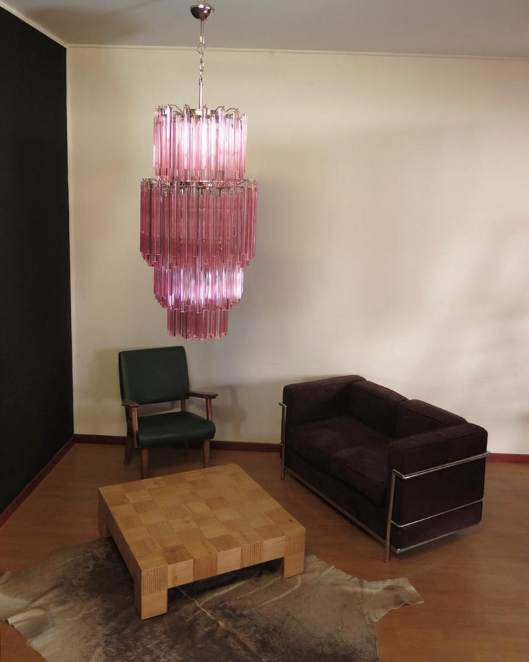Fantastic vintage Murano chandelier made by 242 Murano crystal pink prism (TRIEDRI) on four levels in a nickel metal frame. The glasses have two different sizes. Period: 1990s Dimensions: 68.70 inches height (200 cm) with chain, 55.10 inches