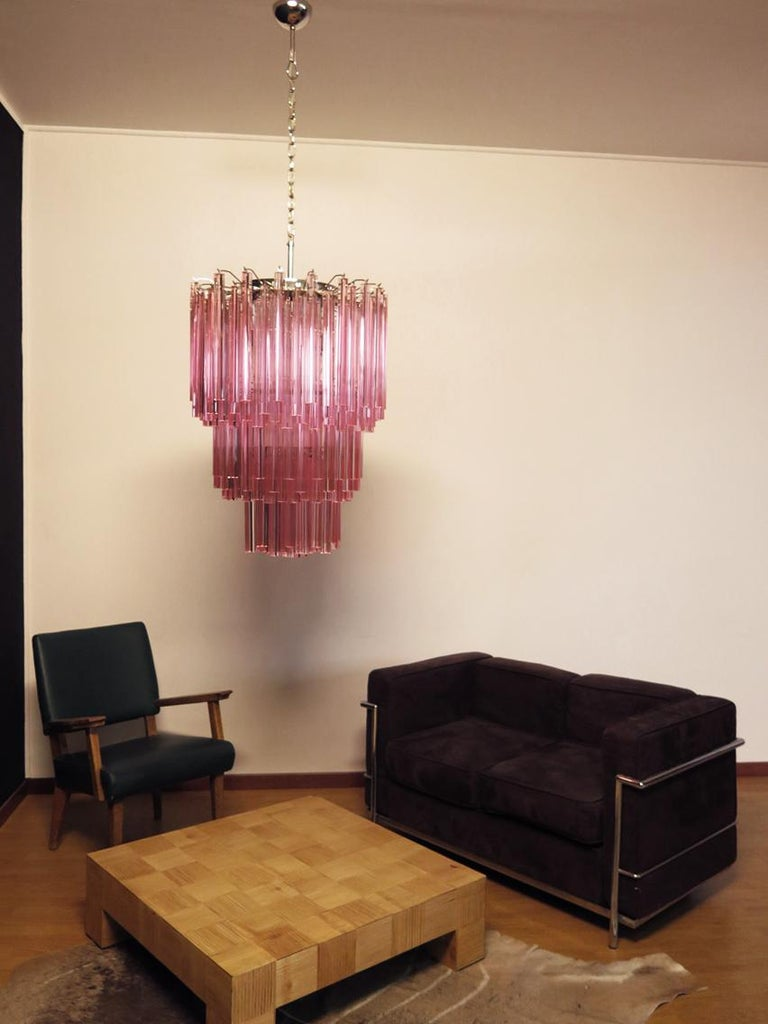 Fantastic vintage Murano chandelier made by 184 Murano crystal pink prism in a nickel metal frame. The glasses have two different sizes.