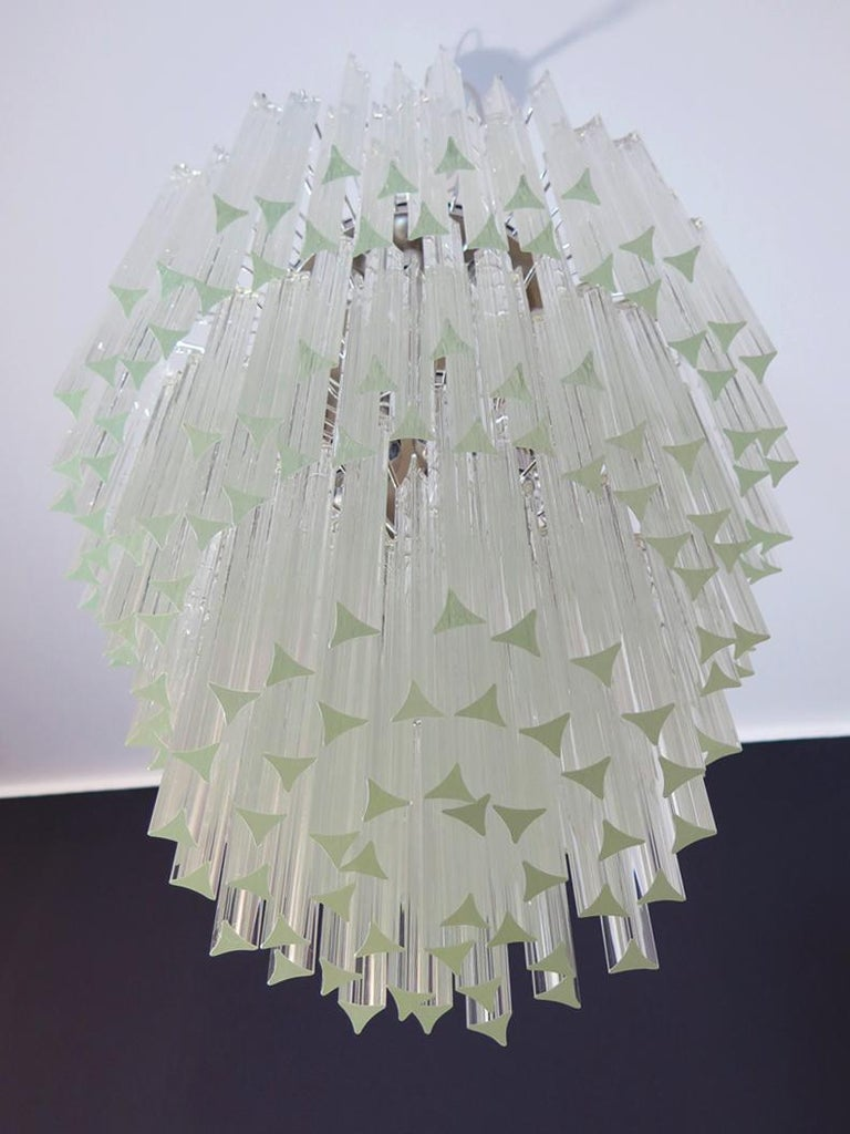 Fantastic vintage Murano chandelier made by 184 Murano trasparent crystal prism in a nickel metal frame. The glasses have two different sizes. Period: late 20th century Dimensions: 66.90 inches height (170 cm) with chain; 37.40 inches height (95 cm)