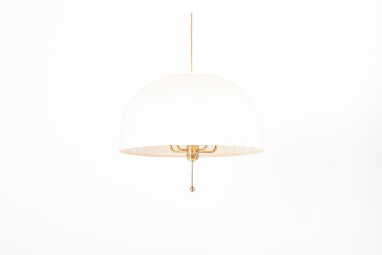 Pendant lamp, huge model of T549, in brass. Designed by Hans-Agne Jakobsson in 1960s and manufactured by AB Markaryd in Sweden.  6 x E27 sockets, each with a maximum of 60 watts.  Please note: Lamp should be fitted professionally in accordance