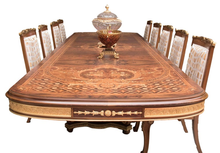 Very large vintage Persian briar wood dining table, with amazing hand-carved floral inlay decoration and golden leaf finishing bronzes. Chairs available but not included. Manufactured by Mice di Domenico Rugiano