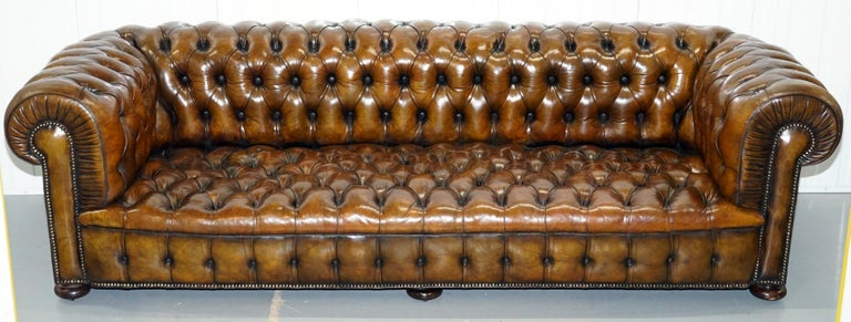 We are delighted to offer for sale this stunning exceptionally rare huge original early Victorian tobacco brown leather fully restored Chesterfield buttoned sofa  This is the model that everyone wants, it is the 100% perfect and correct oversized